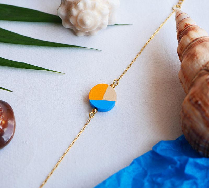 Gebetnout bijoux fantaisie lyon mode tendance bijouterie femme Annecy artisan Opunohu geometrie bois rond jaune bleu bracelet