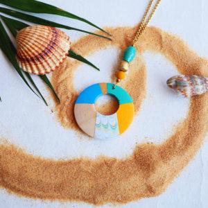 Gebetnout bijoux fantaisie lyon mode tendance bijouterie femme Annecy artisan Opunohu geometrie bois collier sautoir bleu turquoise jaune papier